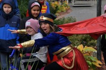 "Barbara is ""flying high"" as Wonder Woman at The Ronald McDonald House in Minnesota delivering warm hats and hugs to kids battling cancer"