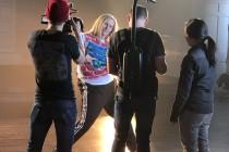 Lori striking a pose on set